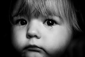 Baby with Tears in Her Eyes Image