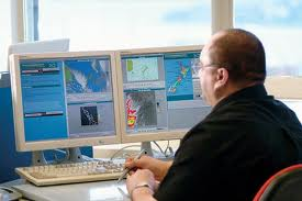 Meteorologist on the Computer Image