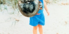 Easy Science for Kids Facts About Xiphosura - Fun Xiphosura Quiz - FREE Xiphosura Worksheet for Kids Image of a Boy with a Horseshoe Crab Shell